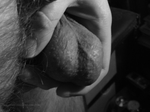My balls, held in my hand, in black and white